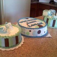 Baby Shower Cake For My Friend  I made these three cakes. 1 cake is chocolate with a white chocolate raspberry cheesecake filling. the 2nd cake is red velvet with a white...