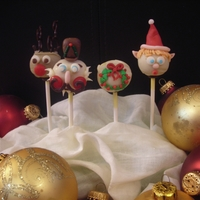 Tis The Season Holiday pumpkin spice cake pops with candy and candy clay accessories.