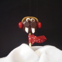 I Am The Walrus Chocolate Mint cake pop with candy and candy clay winter garb :)