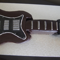 Electric Guitar Choc mud RTR fondant. Completely edible. Inspired by the clients actual electric guitar.