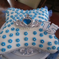 Pillow Cake   My daughter wanted a special cake for her 15th birthday. I made her this pillow cake and tiera (for my princess) in her favourite color