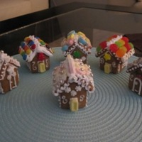 Gingerbread Minis   Mini gingerbread houses used as table gifts for dinner guests. Houses are approx. 2 inches square.