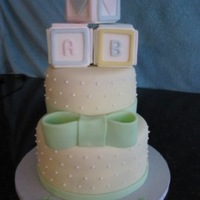 Baby Shower   Gumpaste baby blocks on fondant covered cake.