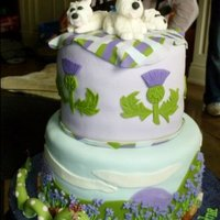 Westies Over Loch Ness   Our friend's 3 West Highland Terriers sitting atop her Scottish themed birthday cake.