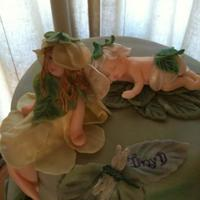 Garden Fairy Cake   A Garden Fairy themed cake for our daughter's baby shower. Fairies and baby are gumpaste painted with lustre dust.