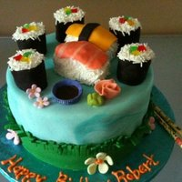 Sushi Anyone Sushi theme cake for a man. Sushi is made from rice krispie treats covered with fondant and sugar sprinkles. Cake is chocolate fudge with...