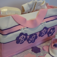 Diaper Bag Cake   DIAPER BAG, DIAPERS, BOOTIES ALL MADE OUT OF FONDANT, BOTTLE AND PACIFIER CHOCOLATE