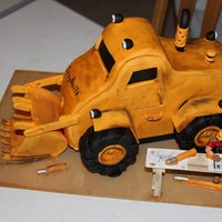 Izzy Built Dozer My husband and some of his friends are into high-end radio controlled construction equipment and semi-trucks. They are having a display...