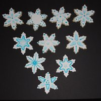 Snowflake Cookies Just practicing some cookie decorating techniques. I don't make decorative cookies very often, but would like to learn.