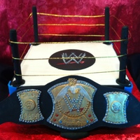 Wwe Birthday Cake Fondant covered chocolate cake with bavarian creme and fresh strawberry filling. All decorations on WWE belt are gumpaste and fondant...