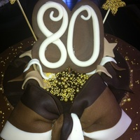 "80Th Birthday Cake  This was for our ""POP's"" 80th Birthday. Chocolate BC, rasberry and chocolate mousse filling with Fondant ribbon and..."