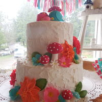 Bright Woodsy Themed Baby Shower Cake Momma and Poppa bird wait for their egg to hatch surrounded by bright flowers and mushrooms.