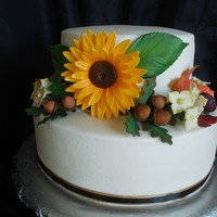 Rustic Autumn Birthday Cake A rustic Autumn Birthday cake with gumpaste sunflowers, acorns, hydrangeas, and autumn leaves.