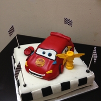 The Cars Themed Cake Lightning McQueen in Chocolate cake with Chocolate frosting.