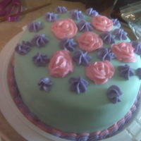 Just Another Practice Cake/first Time Using Mmf Supposed to be teal MMF. Pink roses (at least the are supposed to be roses) and purple large stars.