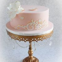 Lace Birthday Cake Marble chocolate cake covered in pink MMF, decorated with Sugar-dress lace and handmade fondant flower with gold accents. I made this cake...