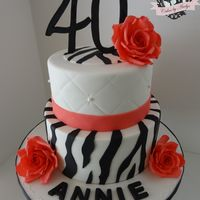 Zebra Print 40Th Birthday Cake Zebra print and Roses 40th birthday cake. Cake is butter vanilla filled with dulce de leche and vanilla bean buttercream, covered in...