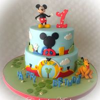 Mickey Clubhouse Cake Mickey clubhouse cake with Mickey and Pluto. This was made for the cutest little boy who loves Mickey and Pluto, and the mom asked to make...