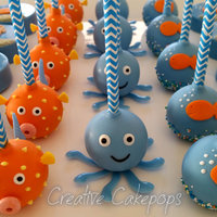 Cake Pops Chocolate Dipped Oreos And A Fish Cupcake Cake For An Under The Sea Themed Birthday Cake pops, Chocolate dipped Oreo's and a Fish cupcake cake for an Under the Sea themed birthday