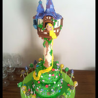 """tangled"" Tower Cake And Cake Pops ""Tangled"" tower cake and matching cake pops. The cake inside is purple velvet and pink vanilla sponge. The outside is fondant and..."
