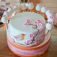 Hand Painted Bird Cake And Cake Pops Hand painted Robin in cherry tree branches with gumpaste flowers and matching cake pops