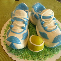 Pair Of Tennis Shoes I made this pair of tennis shoes from rice krispie treats. I covered them with vanilla candy melts and then MMF. My boss loved it! I got...