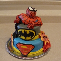 Super Hero Cake Vanilla cake with buttercream frosting. Spider man is made of RCT. I had so much fun with this cake - my grandson loved it! Special thanks...