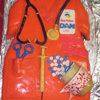Nurse Scrub Attempted to make a nurse scrub with pill bottle, syringe, bandaid, scissors, name tag, and stethescope. Fondant and gumpaste. It didn&#039...