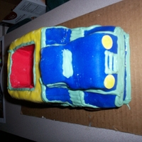 Dump Truck   Cake covered in fondant with frosting details. The bed was later filled with candy :)