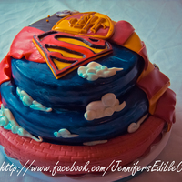 Superman/harry Potter Cake This cake was made for a brother and sister. One into Superman and the other into Harry Potter.