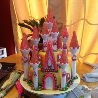 Princess Castle Cake I used the Wilton Castle cake set and managed to make it sturdy enough to transfer the cake with the towes on.