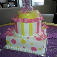 1St Birthday Cake 1st Birthday Hot Pink and Yellow Butterfly cake. The small topper cake was removable and was the baby's smash cake. :)