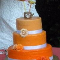 Orange Wedding Cake This is the second wedding cake that I have ever made. The top two tiers are styrofoam and the bottom tier is lemon cake with vanilla...