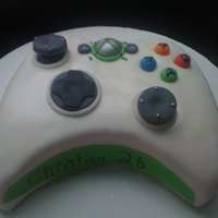Xbox Controler Birthday Cake Chocolate cake with strawberry mousse and chocolate mousse layers. Add decorations are fondant. The controler pieces are movable all edible...