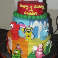 Yo Gabba Gabba Cake. 3 tiered Yo gabba gabba themed cake. It comes with matching cupcakes and cookies.