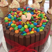 Kitkat Barrel With M&ms Vanilla sponge, kit kats, M&Ms and a very hungry-looking bloke diving in!