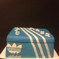 Adidas Adidas Shoe box Cake. Vanilla cake filled with fresh strawberries and banana custard. Meringue buttercream icing