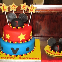 Mickey Mouse! First Birthday Cake with Matching Smash Cake. The cake was chocolate with vanilla Swiss meringue and the smash cake was vanilla with...