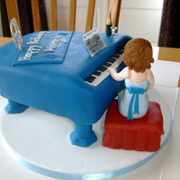 Grand Piano Birthday Cake my first attempt at a piano. Lemon madeira cake with raspberry jam and vanilla buttercream filling. Carved and covered with fondant. Piano...