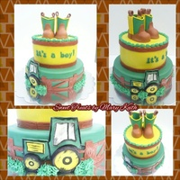 Cowboy Boot Topper Baby Boy Shower Cake With an edible cowboy boot topper and a small John Deere tractor.