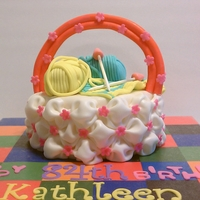 Cake Yarns With Knitted Scarf In A Billow Basket. THis cake was made for a newly found friend and neighbour who is celebrating her 84th bday. She loves knitting. With this cake, It's...