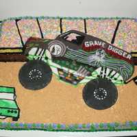 Monster Truck Show 18x24 inch cake showing one of the most popular monster trucks. Alot of piping and fondant work along with spinkle stands and graham...