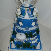 "A ""cinderella's Wedding"" Birthday Cake This seven layer 4 tier cake was quadruple chocolate fudge cake and Vanilla cake swirl. Homemade buttercream dyed blue with white..."
