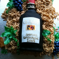 Wine Bottle Cake   My friend is a wine addict and this is her favorite! Red wine in wood