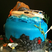 Boat Cake  My Boss's dad's birthday - his boat is his pride and joy :)all rock life and sea creatures made by my 12 yr old daughter Mckenna...