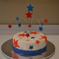 "4Th Of July ""fireworks"" Cake Confetti cake with buttercream coat and fondant. Fondant accents with chocolate ""fireworks"" stars. TFL : )"