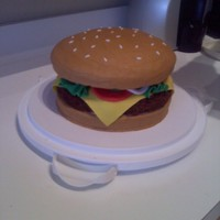 Cheeseburger! Bun frosted with BC, fondant condiments : )