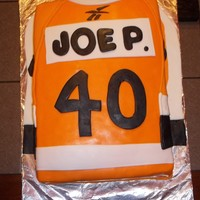 Lets Go Flyers !!!!!  Hi made this cake for a friends husband who loves the Flyers and was turning 40 this past weekend, he loved it. It was the first jersey...