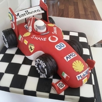 "Formula 1 Cake I was given a picture for this cake, this is not my design. Racing car is krispie treats covered in fondant with 12"" square sponge."