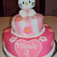 Hello Kitty Cake TOP TIER - WHITE CAKE WITH BUTTERCREAM FILLINGBOTTOM TIER - CHOCOLATE CAKE WITH CHOCOLATE PUDDING FILLING